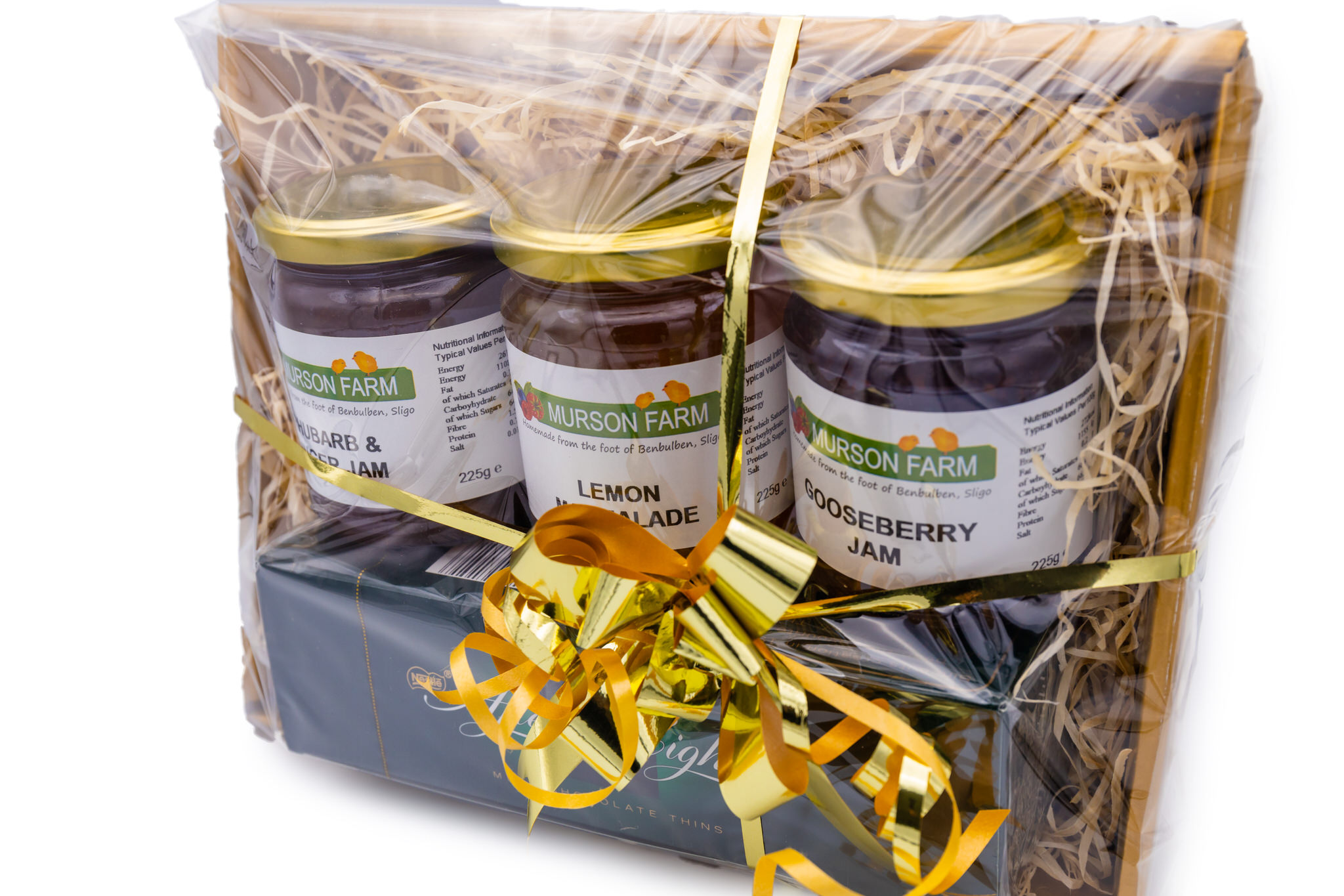 three jars of jam with box of After Eights in hamper