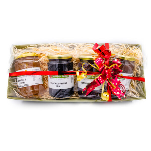 Hamper of 4 jams and marmalades wrapped and tied with a bow