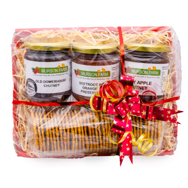 three jars of chutney with cracker hamper