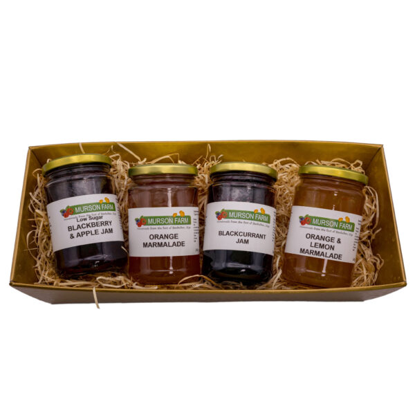 Gift hamper of four jams and marmalades on white background